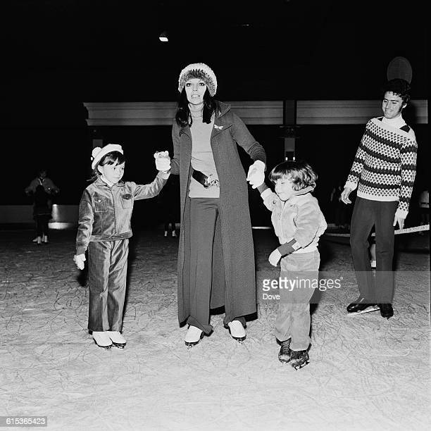 English actress Joan Collins takes her children Sacha and Tara skating at Queensway ice rink in London UK 11th March 1971