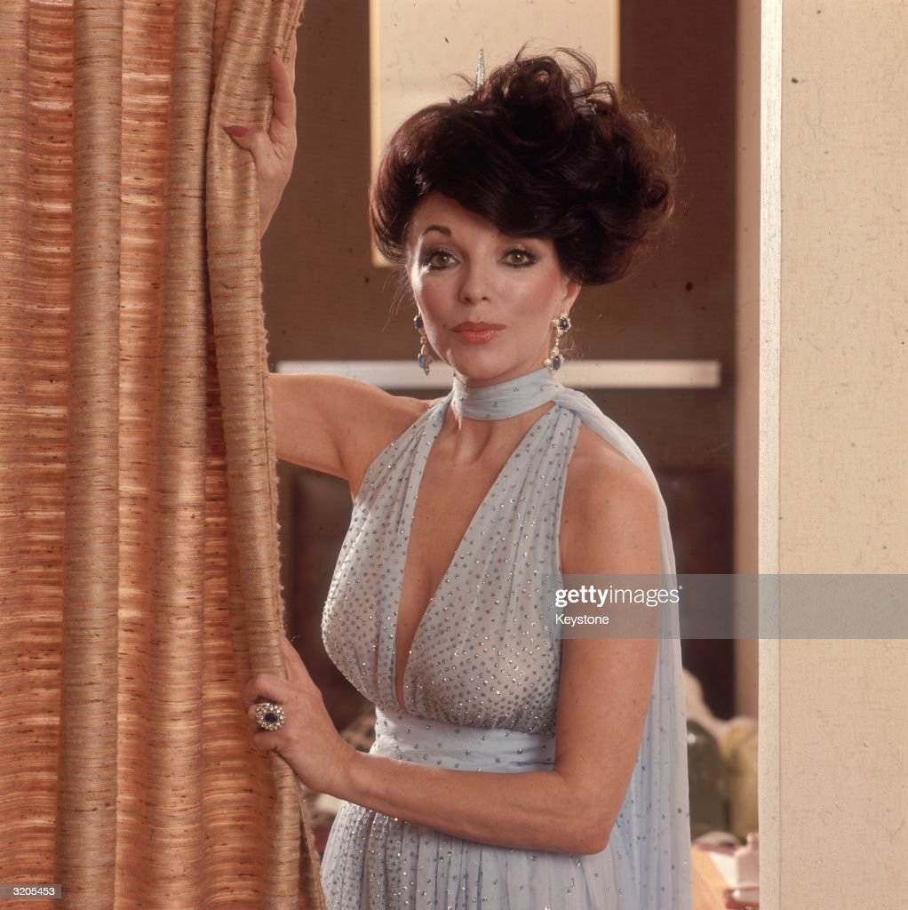 English actress Joan Collins wearing a halter neck dress decorated with sequins.