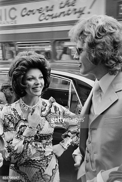 English actress Joan Collins wearing a mididress UK 29th May 1970