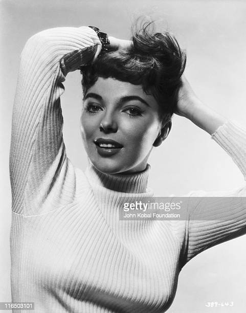 English actress Joan Collins wearing a polo neck jumper 1955