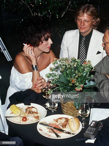 English actress Joan Collins with her husband Peter Holm a former pop singer and Swedish playboy circa 1986