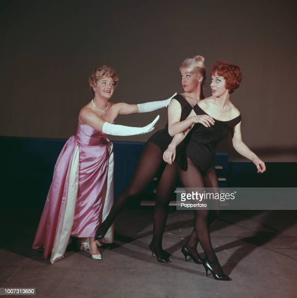 English actress Joan Sims pictured on left in rehearsal with members of the cast of the theatre revue 'The Lord Chamberlain Regrets' in 1961