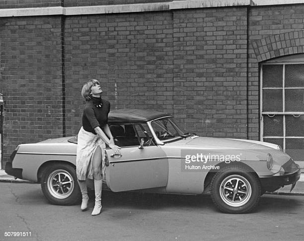 English actress Joanna Lumley as Purdey in the British secret agent fantasy adventure TV series 'The New Avengers' 1976 She is getting out of an MG...