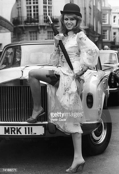 English actress Joanna Lumley star of TV's 'The New Avengers' poses in London with her costar's trademark bowler hat and umbrella 8th March 1976