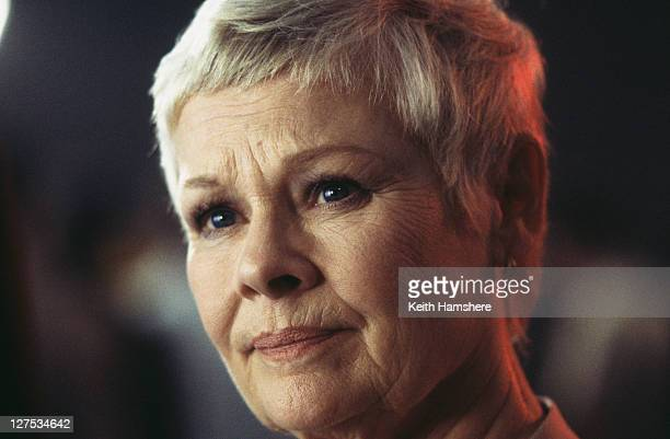 English actress Judi Dench as M, the head of MI6, in a scene from the James Bond film 'The World Is Not Enough', 1999.