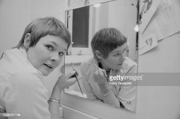 English actress Judi Dench doing her makeup in front of a mirror UK 15th October 1975