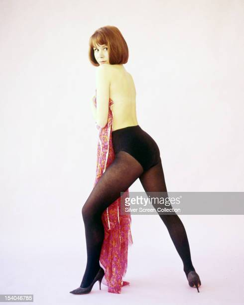 English actress Judy Carne in tights and high heels circa 1966