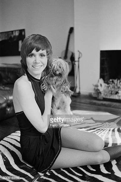 English actress Judy Carne with a small dog UK 15th March 1970