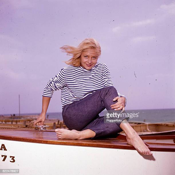 English actress Judy Cornwell posed on a rowing boat on an English beach in 1964