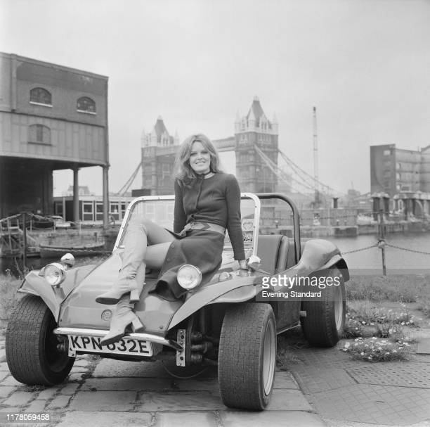 English actress Judy Loe seated on the bonnet of a GP Beach Buggy at St Katharine Docks in London on 9th September 1970