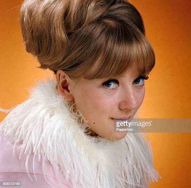 English actress Julia Foster posed wearing a high hair beehive hair style in 1966.