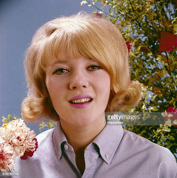 English actress Julia Foster posed wearing a lilac shirt in 1965.