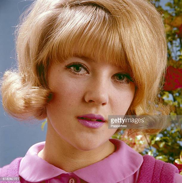 English actress Julia Foster posed wearing a pink blouse in 1965.