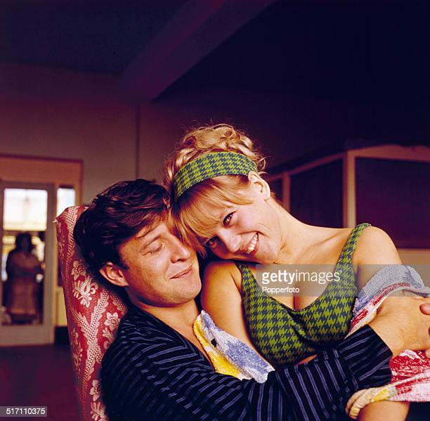 English actress Julia Foster posed with actor Terry Palmer on the set of Allan Prior's television drama 'They Throw It at You' in 1964