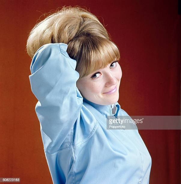 English actress Julia Foster posed with high hair beehive hair style and light blue shirt in 1966.