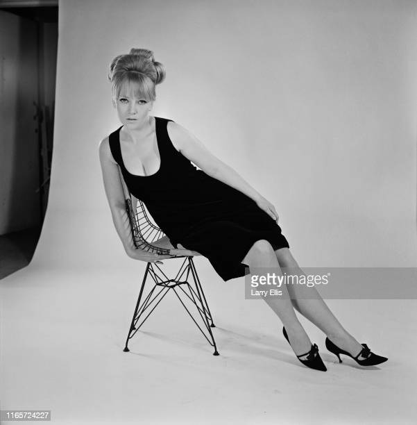 English actress Julia Foster sitting on a chair during a photo shoot, UK, 5th May 1965.