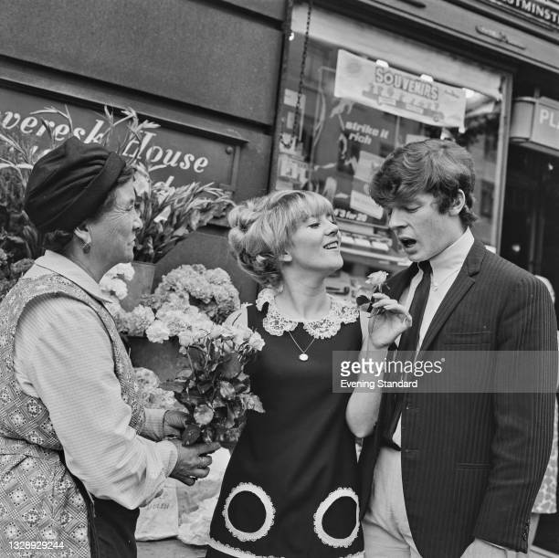 English actress Julia Foster with her fiancé, musician Lionel Morton of the Four Pennies, UK, 6th August 1965.