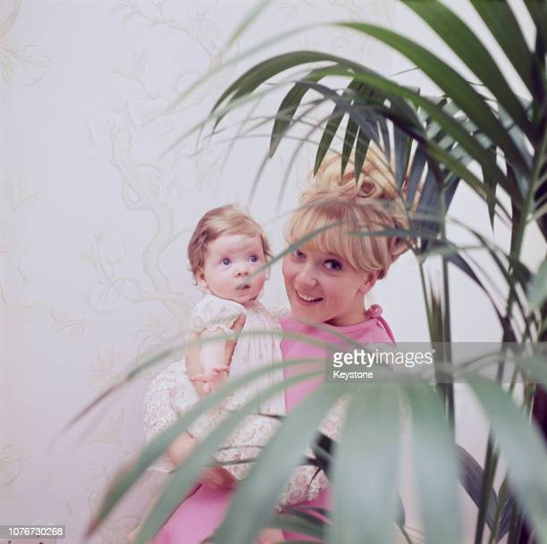 English actress Julia Foster with her infant daughter Emily-Jane, 1968.