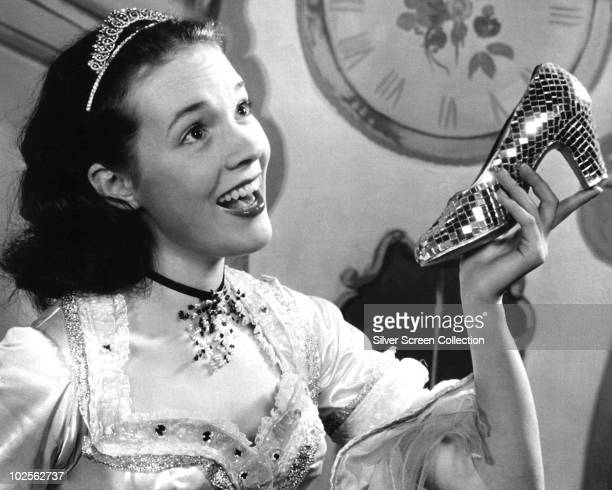 English actress Julie Andrews poses with a glass slipper in the role of Cinderella circa 1957 She played the fairytale character in a film adaptation...