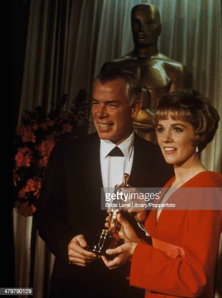 English actress Julie Andrews presents American actor Lee Marvin with the Best Actor award for his performance in the film 'Cat Ballou' at the 38th...