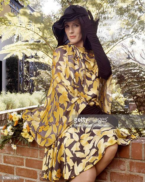 English actress Julie Andrews wearing a silk print outfit with black hat and matching evening gloves in a promotional portrait for 'Star' directed by...