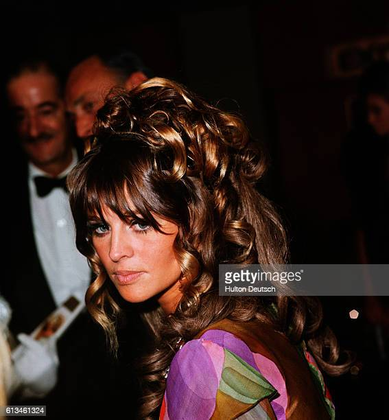 English actress Julie Christie wearing a colorful dress and a hairpiece at the Royal premiere of the film Far From the Maddening Crowd