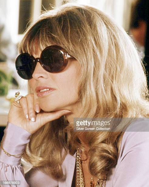 English actress Julie Christie wearing sunglasses as Jackie Shawn in 'Shampoo' directed by Hal Ashby 1975