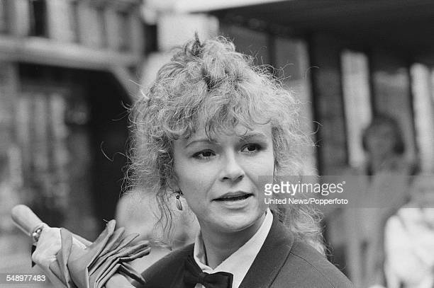 English actress Julie Walters who plays the character of Rita White in the film 'Educating Rita' pictured wearing a bow tie and tuxedo jacket in...