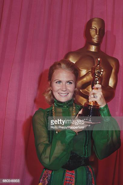 English actress Juliet Mills pictured holding the Best Supporting Actor Oscar statuette awarded to her father John Mills for the film 'Ryan's...