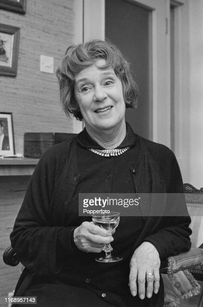 English actress Kathleen Harrison holding a drinking glass at home in January 1966 Kathleeen Harrison currently appears as Alice Thursday in the...