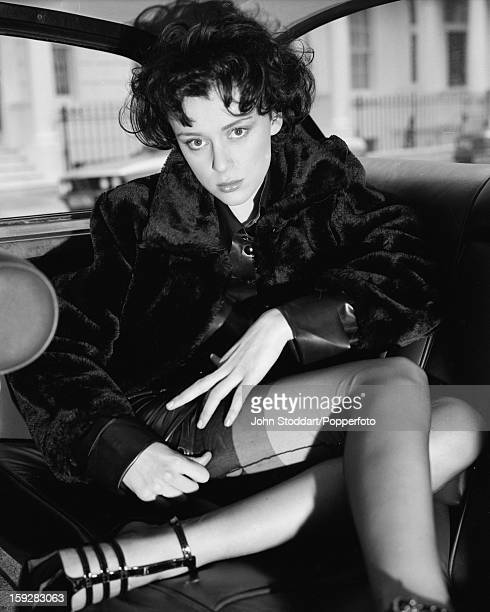 English actress Keeley Hawes in the back seat of a taxi 1996