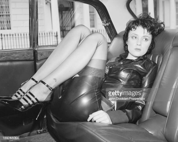 English actress Keeley Hawes in the back seat of a taxi in 1996