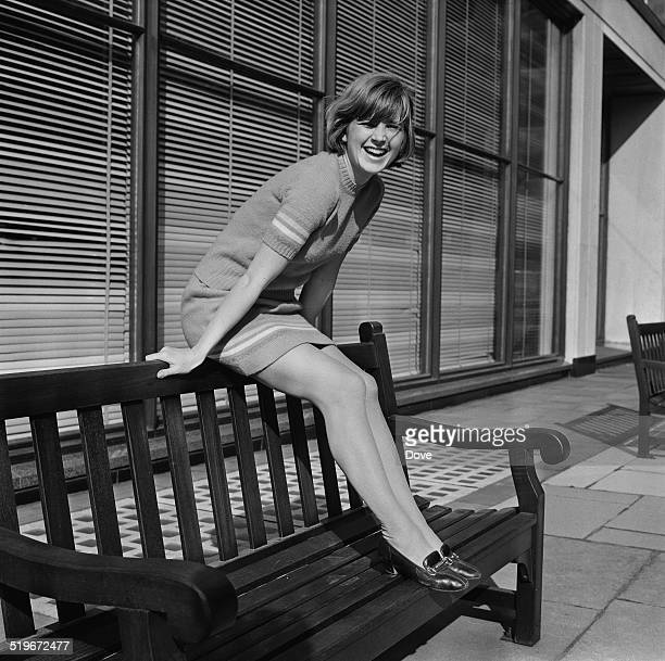 English actress Kim Braden posing on a bench 31st May 1968