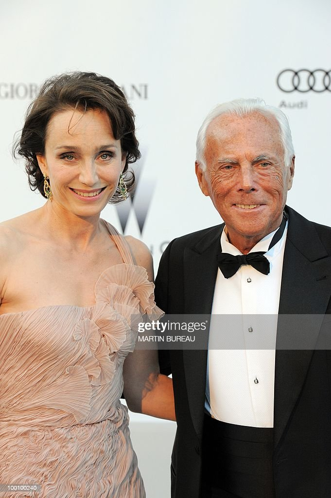 English actress Kristin Scott Thomas and Italian designer Giorgio Armani arrive at amfAR's Cinema Against Aids 2010 benefit gala on May 20, 2010 in Antibes, southeastern France.