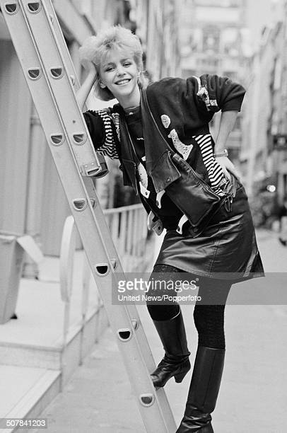 English actress Leslie Ash posed standing on a ladder in London on 13th October 1983
