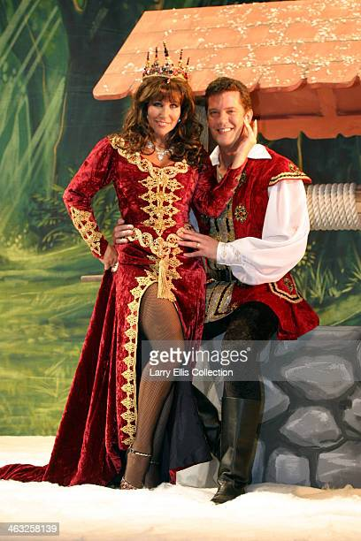 English actress Linda Lusardi as the evil Queen Lucretia with her husband Sam Kane as the Prince in the pantomine 'Snow White and the Seven Dwarfs'...