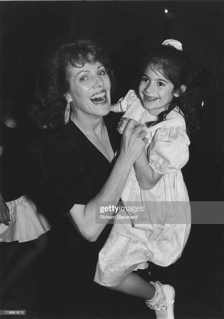 English actress Lynn Redgrave (1943 - 2010) with a little girl at the Cannes Film Festival, France, during a screening of the film 'Getting It Right', 13th May 1989.