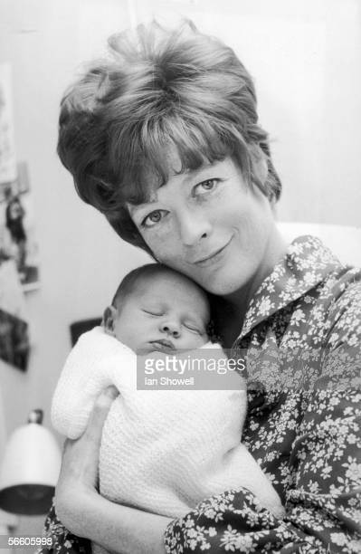 English actress Maggie Smith at the Middlesex Hospital with Toby, her baby son with actor husband Robert Stephens, 5th May 1969.