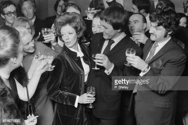 English actress Maggie Smith celebrating her Academy Award for Best Actress with her husband English actor Robert Stephens and friends 8th April 1970