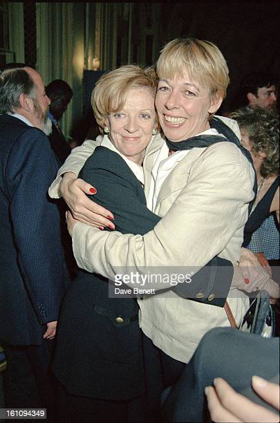 English actress Maggie Smith is congratulated by actress Frances de la Tour at the Evening Standard Drama Awards London November 1994 Smith won the...