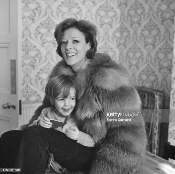 English actress Maggie Smith wearing a fur coat with her son Chris Larkin UK 21st April 1970
