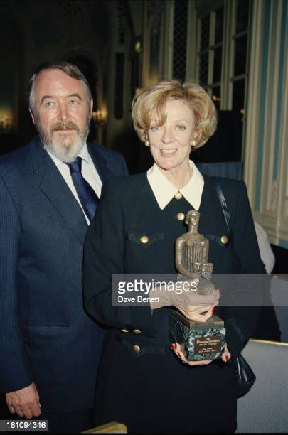 "English actress Maggie Smith , winner of the Best Actress award for ""Three Tall Women"" poses with her husband, playwright Beverley Cross , at the..."
