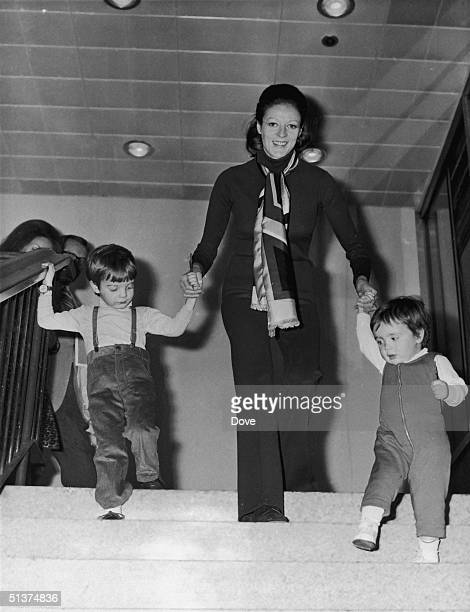 English actress Maggie Smith with her two children Chris Larkin and Toby Stephens at London Airport March 1971