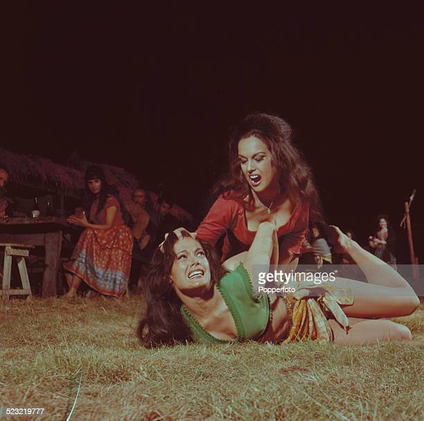 English actress Martine Beswick and Israeli actress Aliza Gur in character as gypsy girls Zora and Vida in a fight scene from the James Bond film...