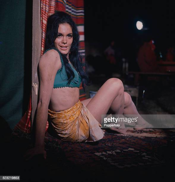 English actress Martine Beswick posed dressed as the gypsy girl Zora on the set of the James Bond film From Russia With Love at Pinewood Studios in...