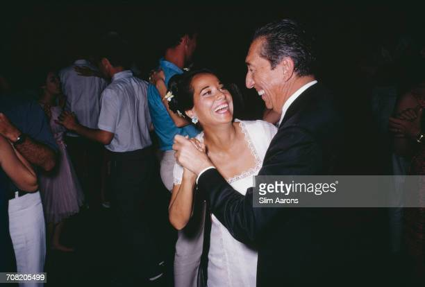 English actress Merle Oberon dancing with former president of Mexico Miguel Alemán Valdés at a party in Acapulco Mexico February 1966