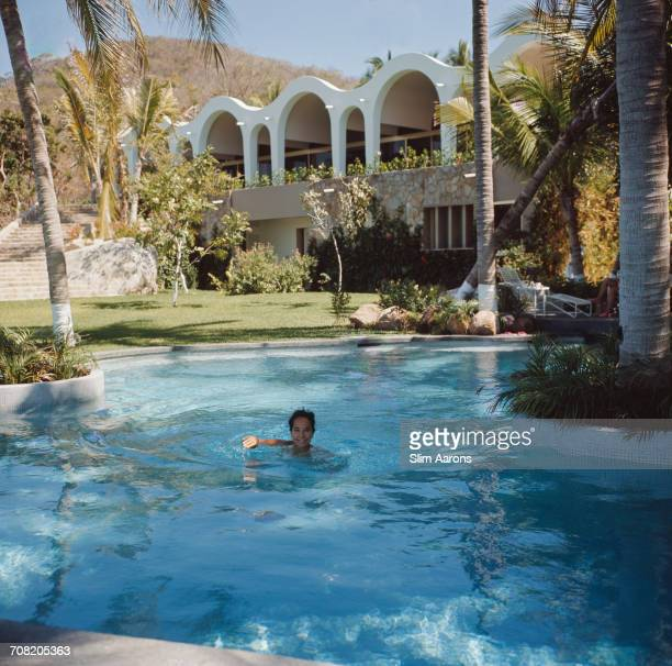 English actress Merle Oberon in a swimming pool Acapulco Mexico February 1966