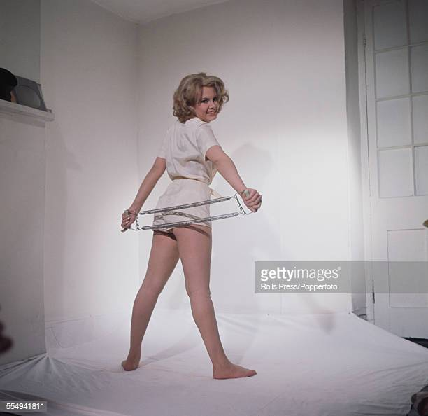 English actress Molly Peters, who plays the character of nurse Patricia Fearing in the James Bond film 'Thunderball', posed wearing a white blouse...