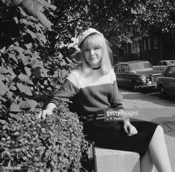 English actress Natasha Pyne wearing Frew McMillan's white cap UK 19th October 1964