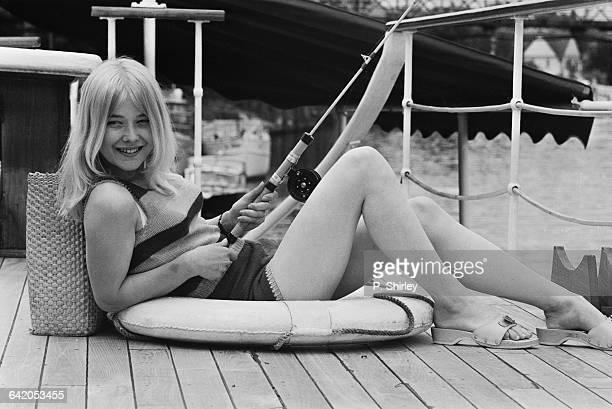 English actress Natasha Pyne with a fishing rod UK 29th May 1971